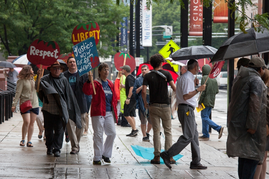 CIW supporters rally in front of Music Hall during the 2015 Kroger shareholders meeting.