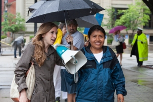 Elena Stein, Alliance for Fair Food, and Julia de la Cruz, Coalition of Immokalee Workers, speak to supporters before entering the June 2015 Kroger shareholder meeting.