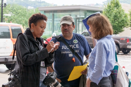 Enquirer reporter interviews representatives of the Cincinnati Interfaith Workers Center