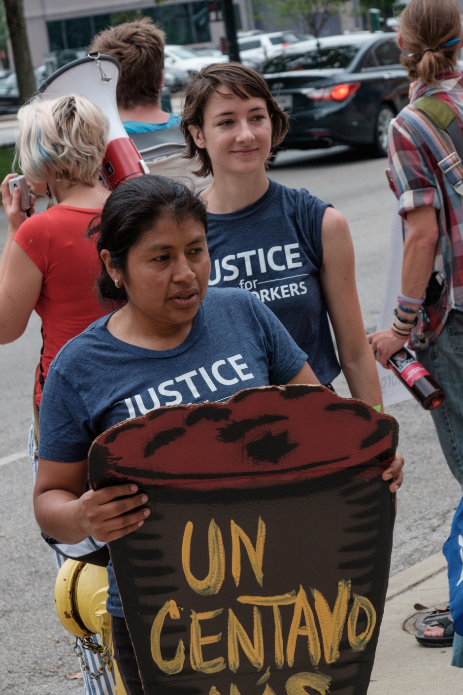Julia de la Cruz, Coalition of Immokalee Workers, protests for change in how Kroger manages its supply chain for agricultural workers. Photo: Paul Davis, C4AD.