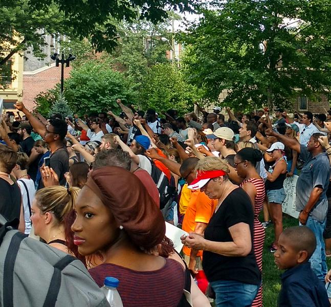 BLMC demonstrators raise their fists in a Black Power salute. Photo: Paul Breidenbach, C4AD.