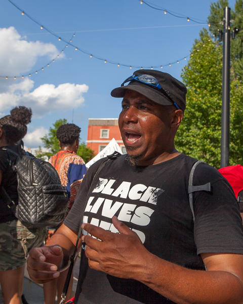 Brian Taylor, a BLMC leader, speaks with reporters after the 'Enough is Enough' rally. Photo: Mike Brown, C4AD.