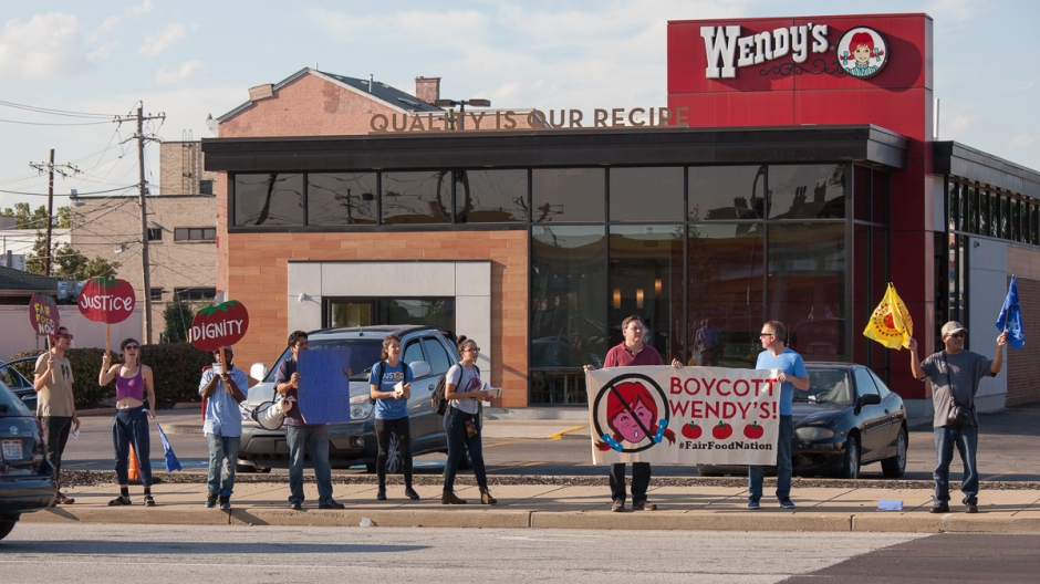 Activists and farmworkers rally at Wendy's on Hopple Street to support national boycott of the fast-food chain.