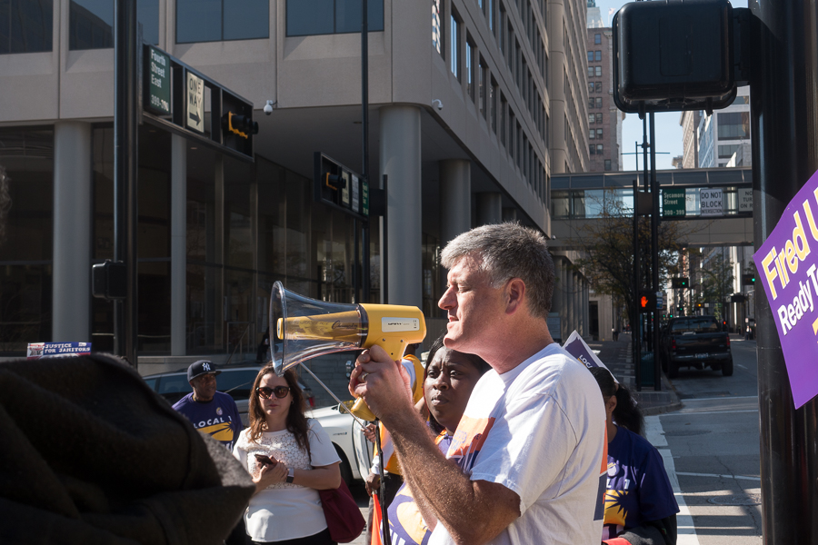 Rev. Troy Jackson, executive director of the AMOS Project, calls the crowd to prayer at Saturday's SEIU rally.