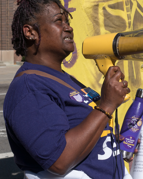 Arnita Summerlin, a janitor and SEIU member, addresses the crowd at Queen City Square in front of the Great American Tower.
