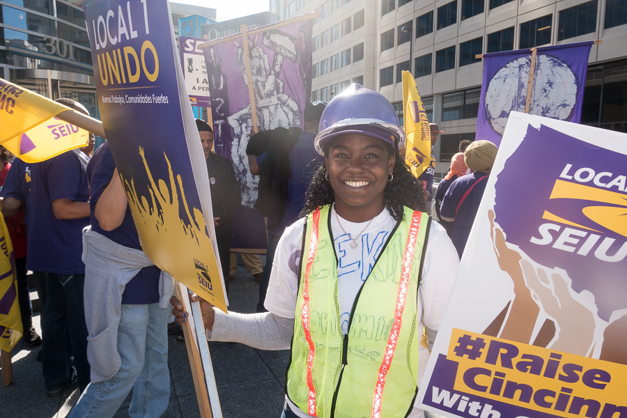 Tamika Maxwell collects signs at the end of Saturday's rally organized by her union, SEIU.