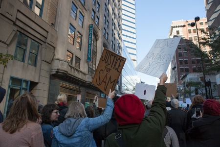 The rally seeking justice for Sam DuBose and his family merged with another protesting the divisive campaign of President-elect Donald Trump. Together they marched through downtown Cincinnati on Saturday.