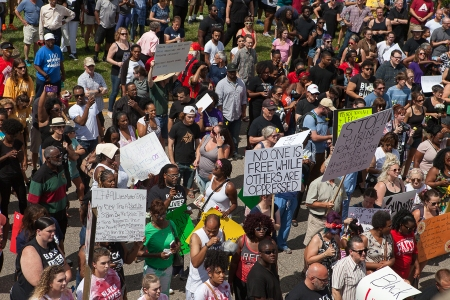 Thousands gathered July 10 for a peaceful rally organized by Black Lives Matter Cincinnati to express frustration over police brutality, racism, and economic injustice.