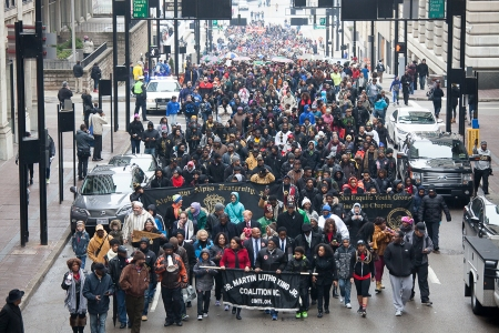 Thousands march up Vine Street from the Freedom Center to Fountain Square led by the MLK Coalition of Cincinnati, which organized the event to honor the legacy of Dr. Martin Luther King. Photo: Mike Brown.